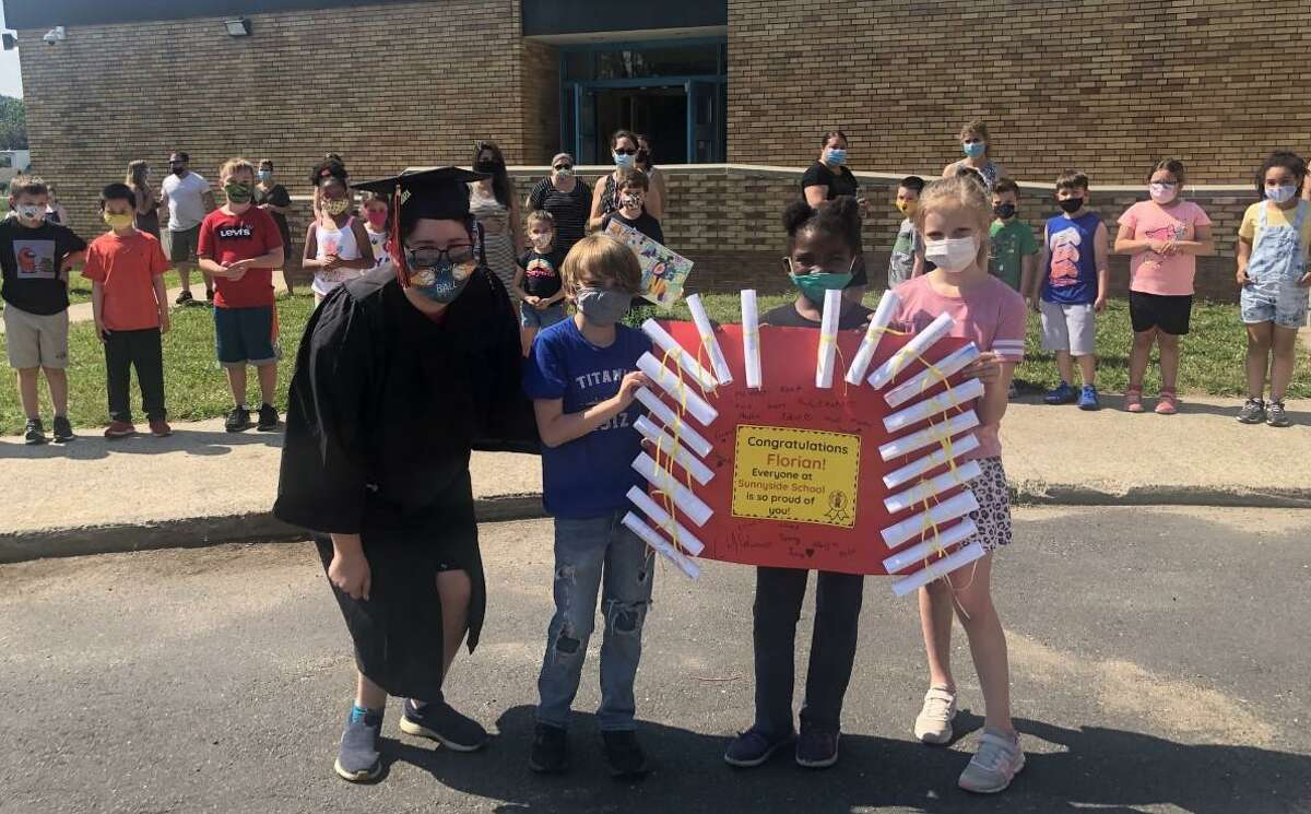 Shelton High seniors returned to their old elementary schools this week. Above, seniors were met with cheers and signs of support at Sunnyside School.