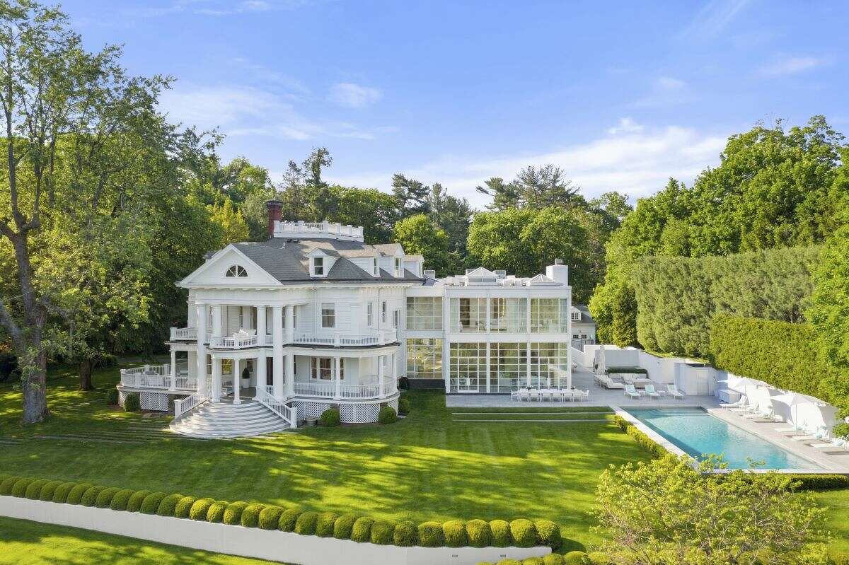 The 25 Edgewood Drive home in Greenwich, Conn. was built in 1905 and was redesigned by architect Allan Greenberg and interior designer Victoria Hagan to update its interior and add a glass and steel addition.