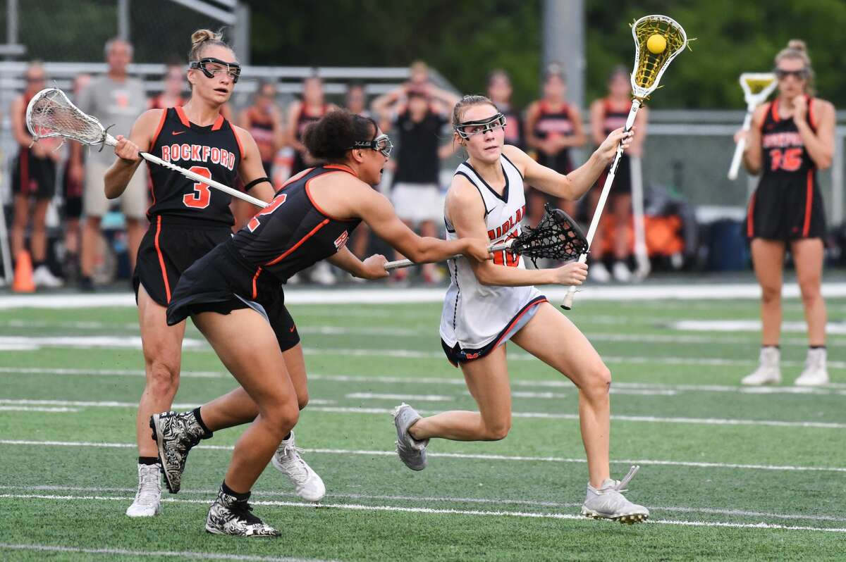 Midland's Emma Murphy runs towards the goal during a state semifinal game against Rockford Wednesday, June 9, 2021 at Haslett High School. (Adam Ferman/for the Daily News)