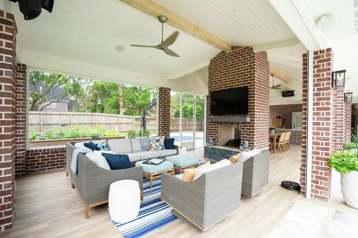 Their new outdoor pavilion has a seating area with ceiling fans and a fireplace for year-round comfort.