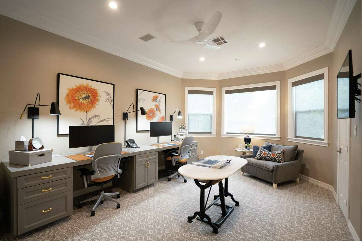 After: A revamped home office has allowed Kristy Crabtree to operate her family's dental practice from home during the coronavirus pandemic.