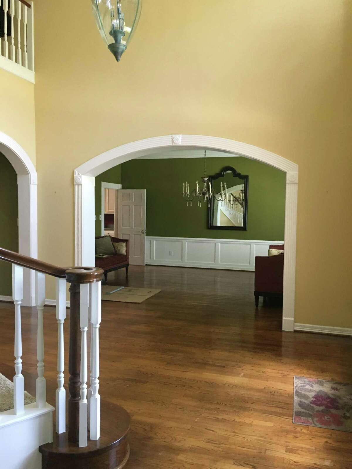 Before: A peek into the dining room shows olive green walls.