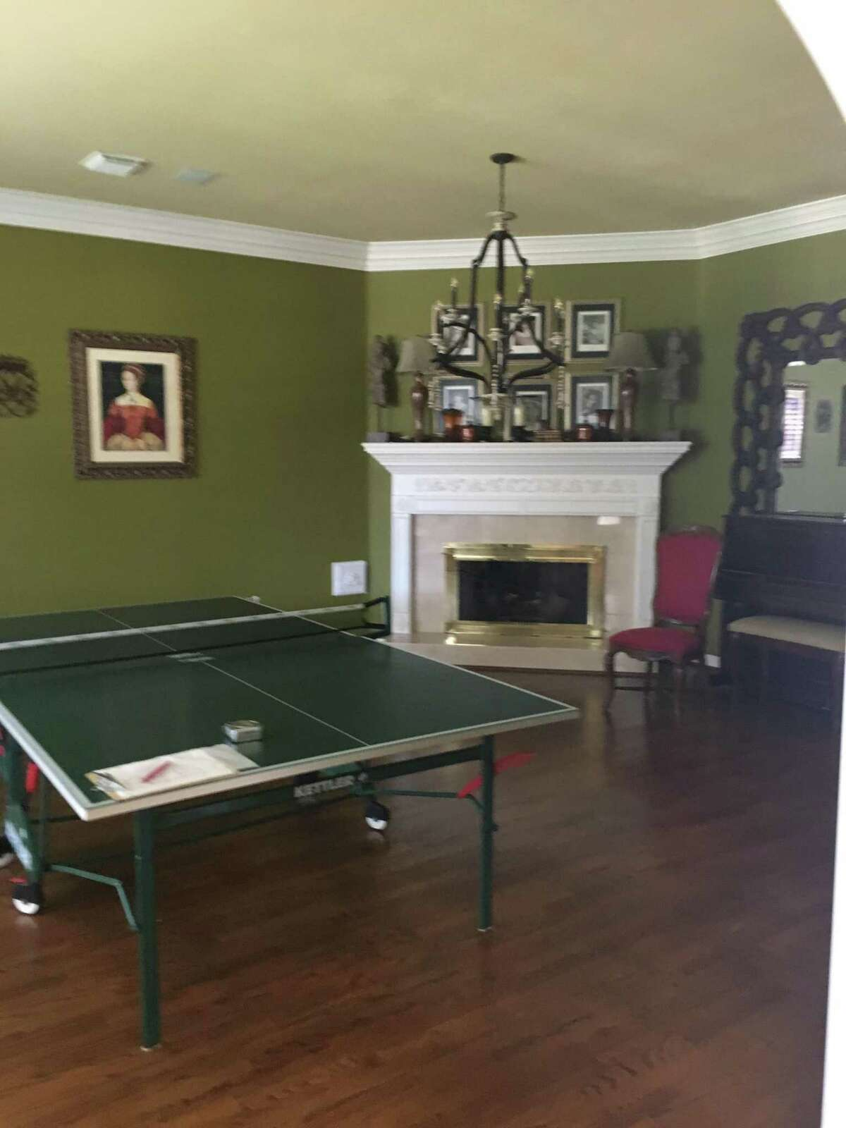 Before: The game room was painted olive green and had little more than a ping pong table.