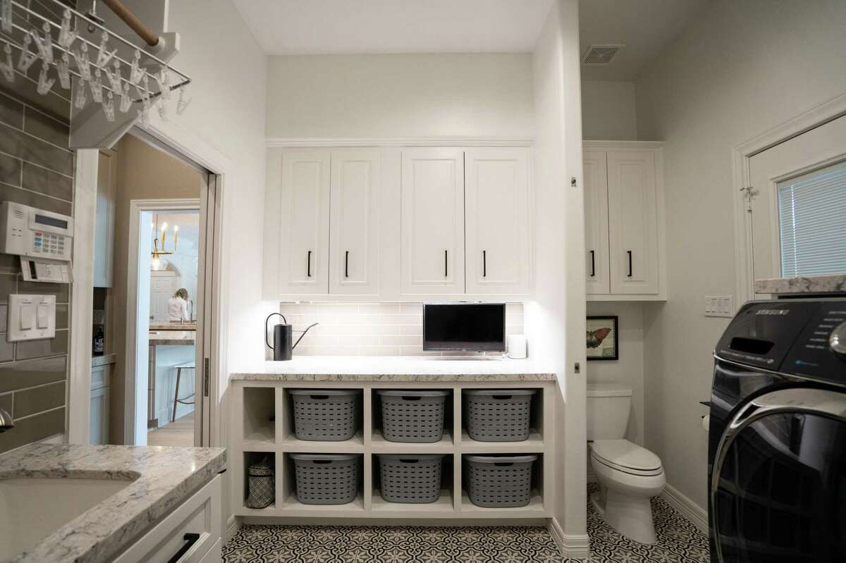 After: A short wall of open cubbies allow for baskets to store and sort things, or keep laundry.