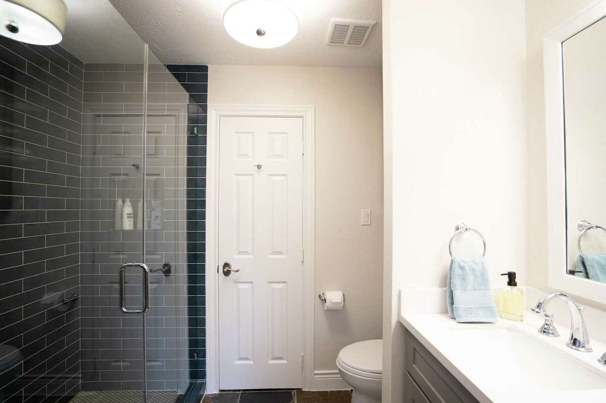 After: A wall of pretty blue tile works well with the blue-gray slate tile floor that was already there.