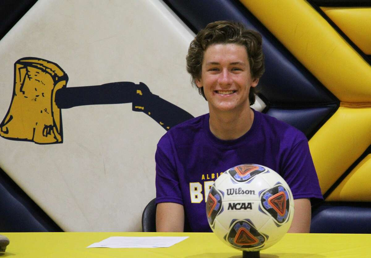 Bad Axe graduate and Hatchet boys soccer MVP Liam Boyle signed a letter of intent on Thursday morning in the Bad Axe High School gymnasium to attend and play soccer for Albion College.