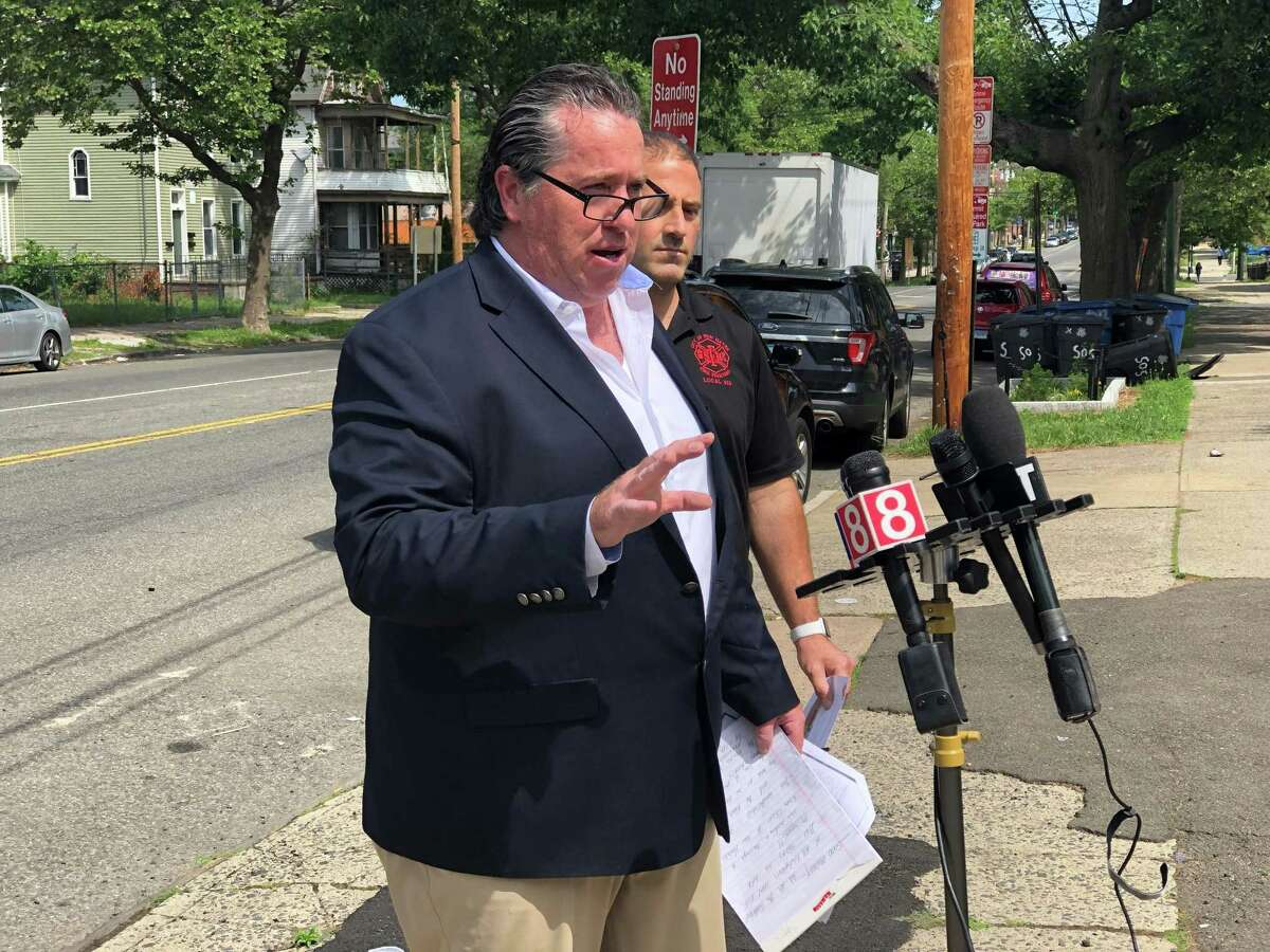 Patrick Cannon and Daniel Del Prete, president and vice president of IAFF Local 825, urged New Haven officials Thursday to fill a series of vacant positions within the department. Here, Cannon speaks.