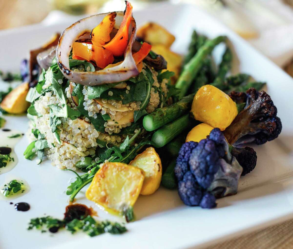 A salad of warm quinoa, kale, toasted almonds, roasted vegetables and lemon citronette will be part of the menu at Bar Loretta, a new bar and restaurant concept coming to San Antonio's King William District.