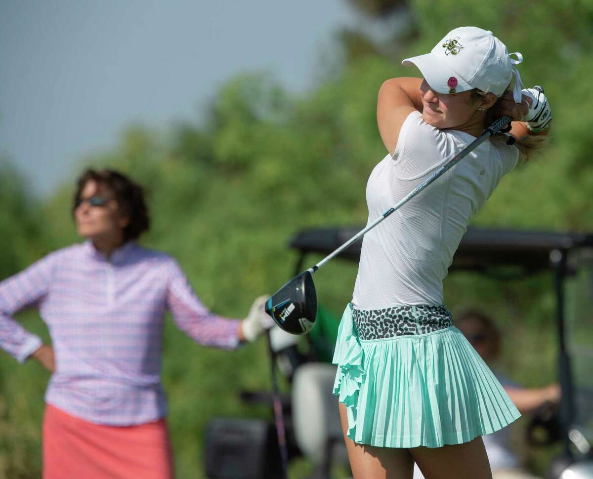 Midland High graduate Mikayla Childers follows her shot in the finals of the First Flight as her opponent Diane Burnett watches 06/10/2021 during the final round of the Women's West Texas Tournament at Midland Country Club. Tim Fischer/Reporter-Telegram