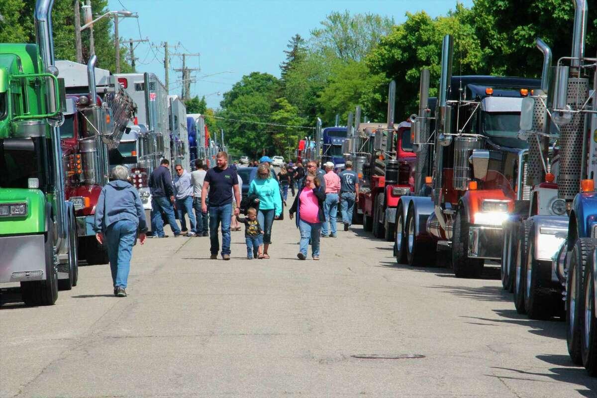 Trucks line up before the caravan starts last year. (Tribune File Photo)
