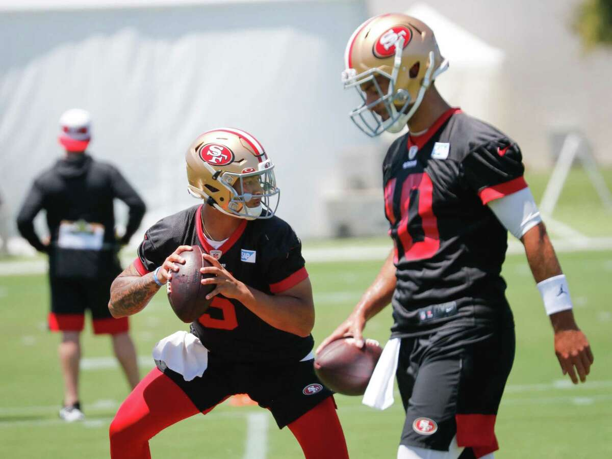 49ers quarterback Trey Lance (5) practices with Jimmy Garoppolo (10) at 49ers headquarters on Wednesday, June 2, 2021 in Santa Clara, Calif.