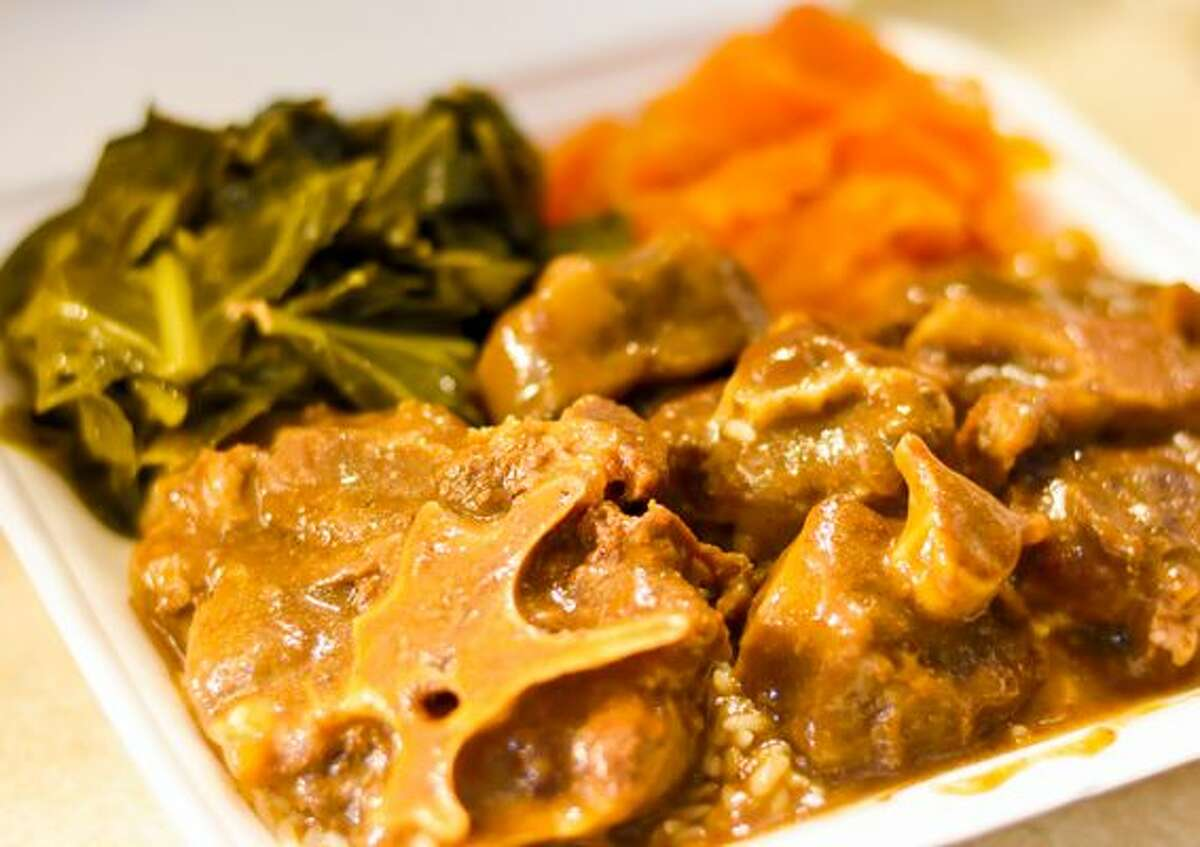 A to-go plate of oxtails, yams and greens from Mikki's Soul Food Cafe in Houston. (Courtesy Craig Joseph/Mikki's Soul Food)