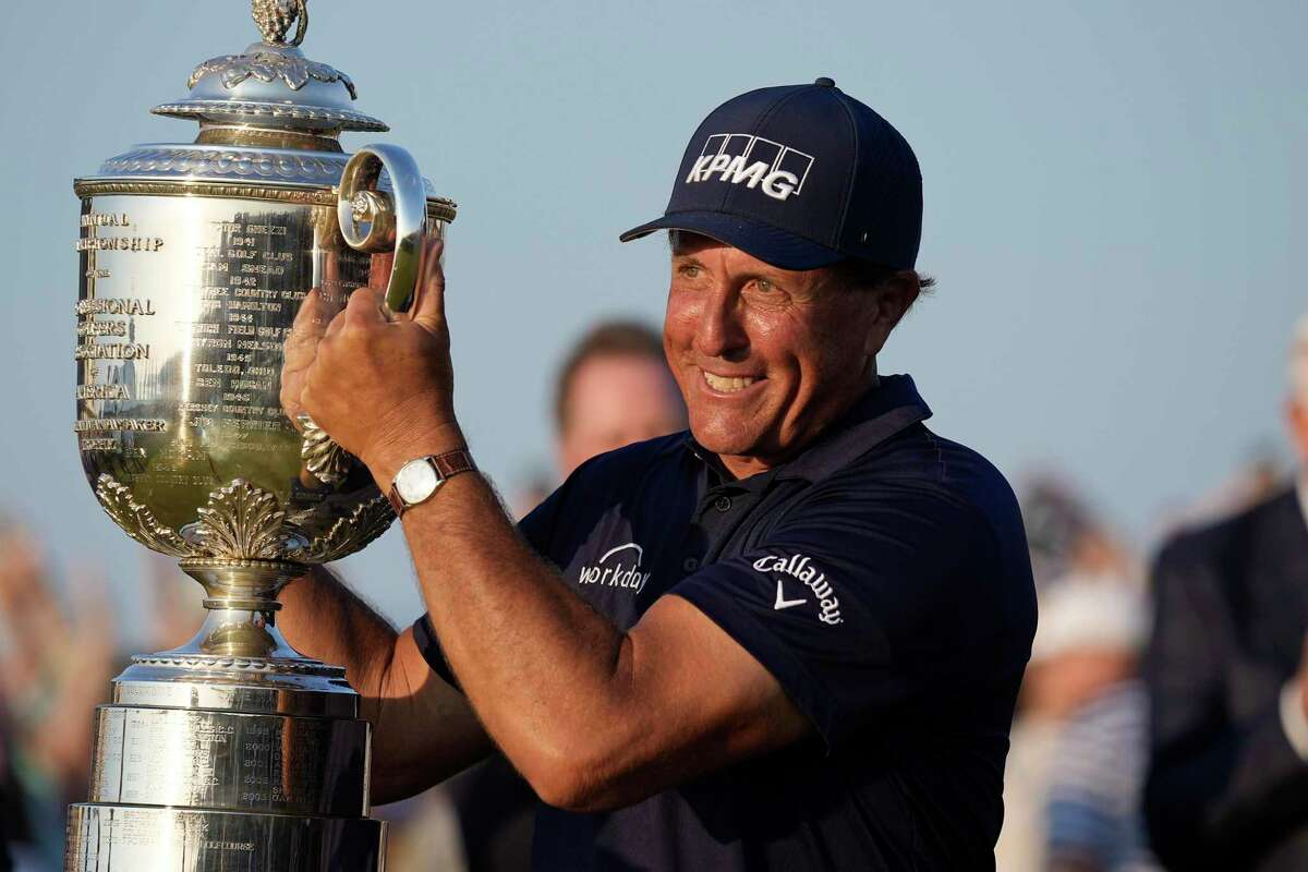 Phil Mickelson holds the Wanamaker Trophy after winning the PGA Championship at the Ocean Course on May 23 in Kiawah Island, S.C. Mickelson committed to the Travelers Championship on Thursday.