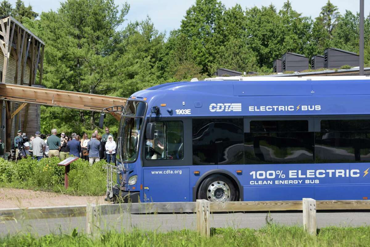 An electric CDTA bus is seen parked at Five Rivers Educational Center for the Albany Nature Bus event on Thursday, June 10, 2021, in Delmar, N.Y. The event was held to highlight the new Nature Bus. The Mohawk Hudson Land Conservancy partnered with the Capital District Transportation Authority (CDTA), New York State Department of Environmental Conservation, State Office of Parks, Recreation, and Historic Preservation and various other partners to introduce the Nature Bus. The Nature Bus is a free service that will provide local communities within the City of Albany rides to neighboring nature preservations. (Paul Buckowski/Times Union)