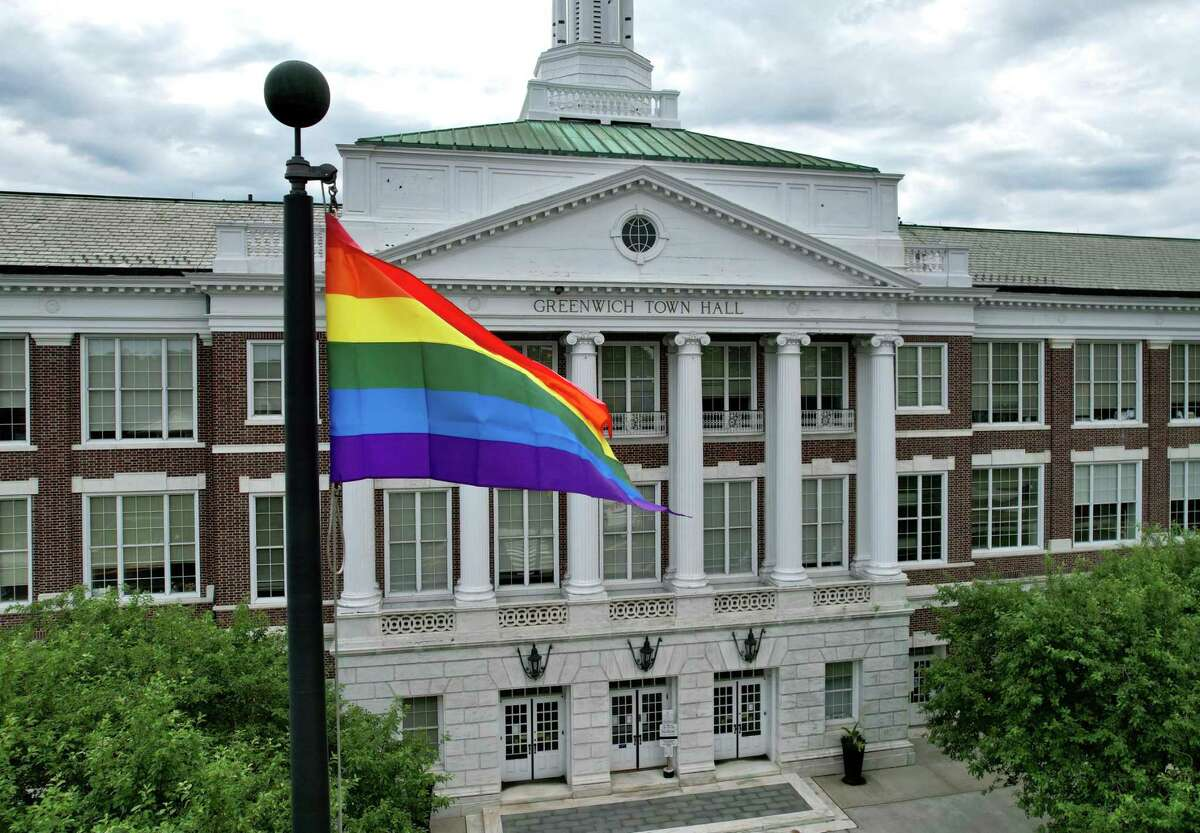 A rainbow flag waves over Town Hall following the Pride Month LGBTQ+ flag-raising ceremony in Greenwich, Conn. Thursday, June 10, 2021. Former Selectman Drew Marzullo, the town's only openly-gay Selectman, joined First Selectman Fred Camillo and U.S. Rep. Jim Himes, D-Conn., to acknowledge the progress that has been made in acceptance of the LGBTQ+ community while noting that there is still much work to be done.