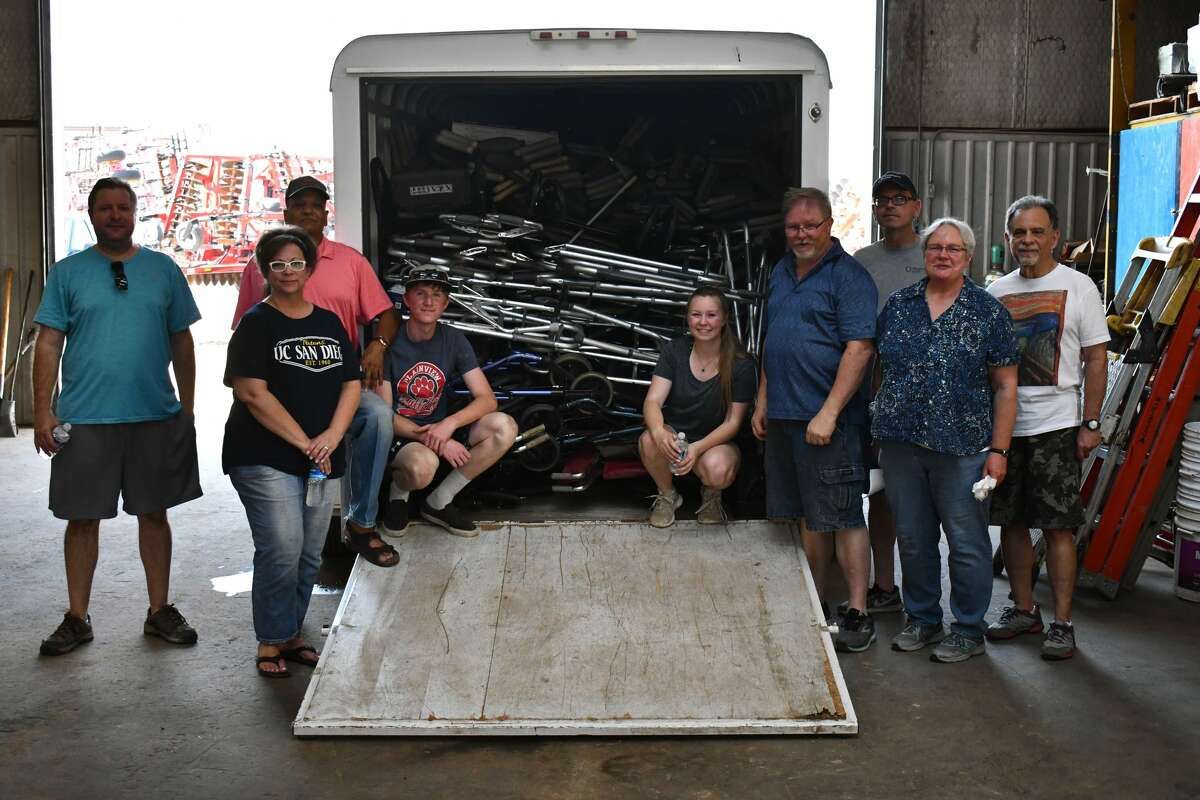 Volunteers load up a trailer of the 270 donated pieces for Crutches 4 Africa on Tuesday at JMS Equipment.