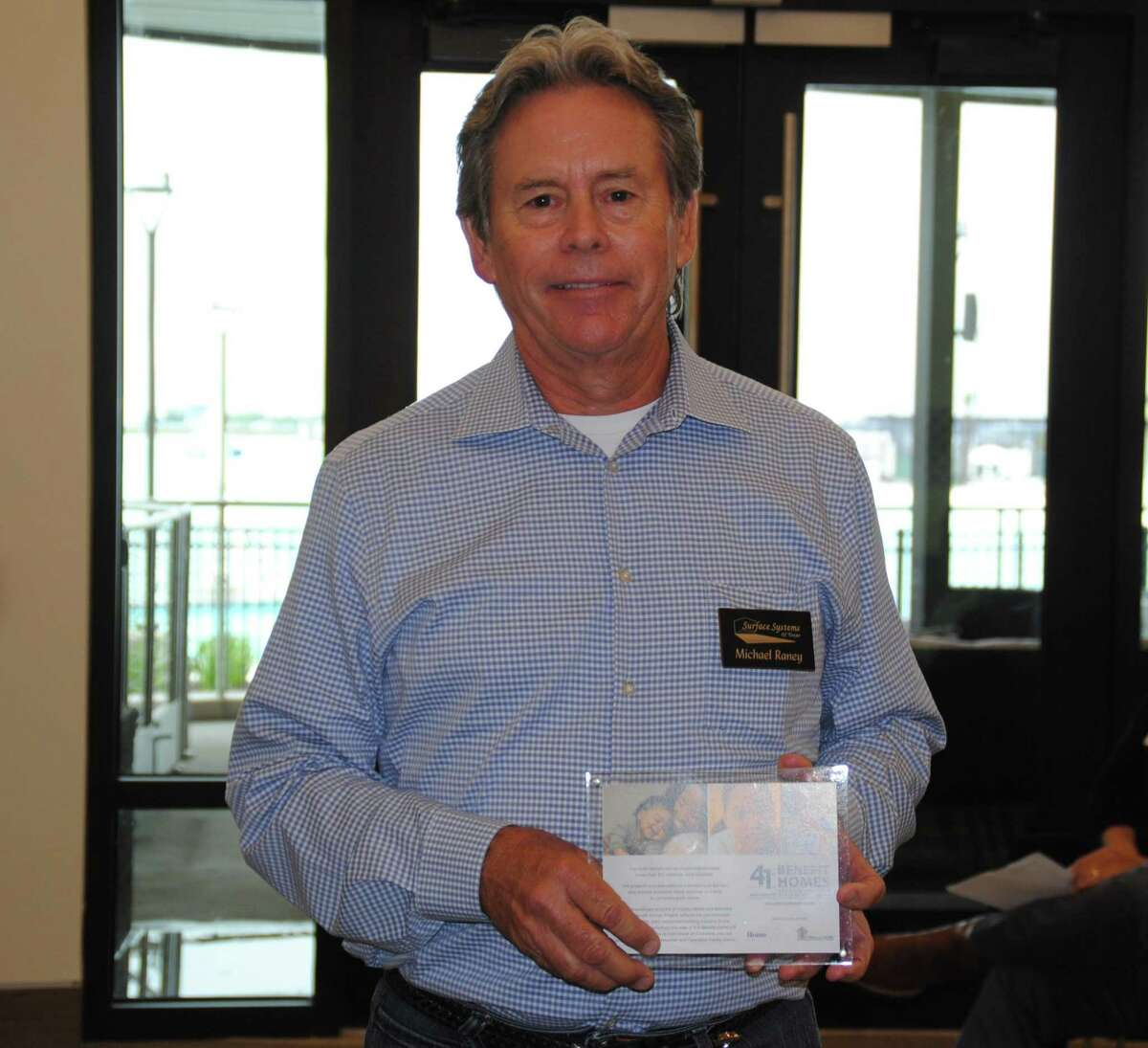 Michael Raney, president of Surface Systems of Texas received an appreciation plaque from Chesmar Homes and the GHBA.