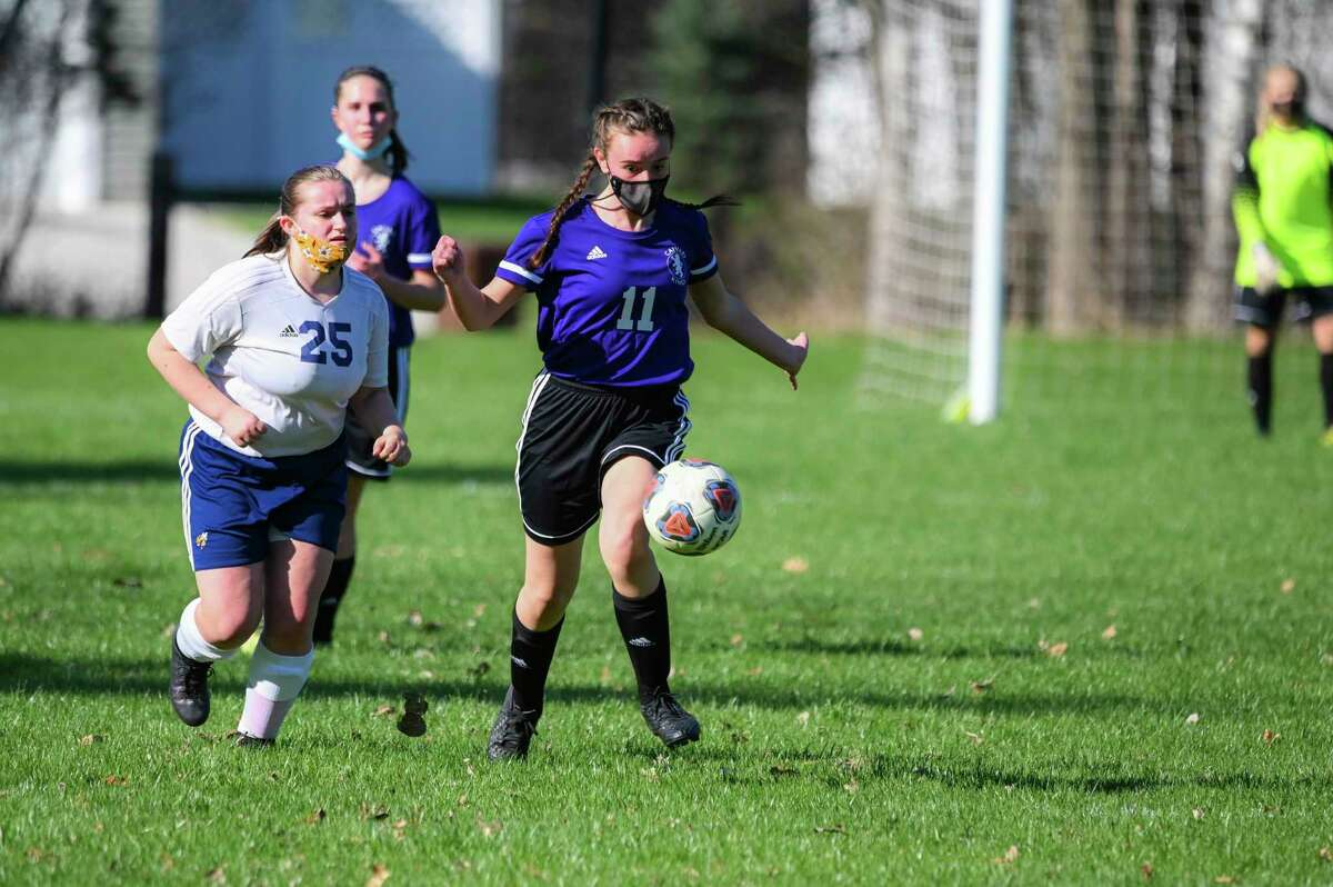 CBA's Ashley Wiggins tries to settle the ball during an April 16, 2021 game against Ithaca.