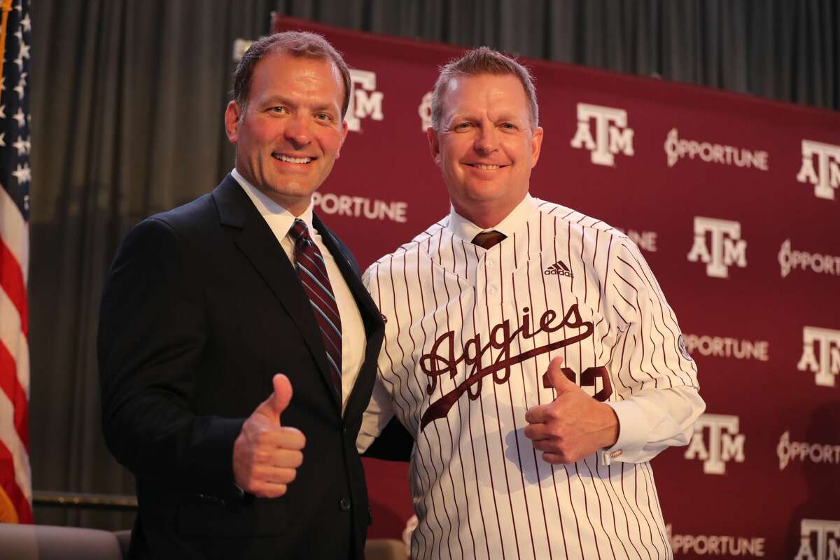 Texas A&M athletic director Ross Bjork (left) introduces new baseball coach Jim Schlossnagle on Thursday in the Hall of Champions at Kyle Field.