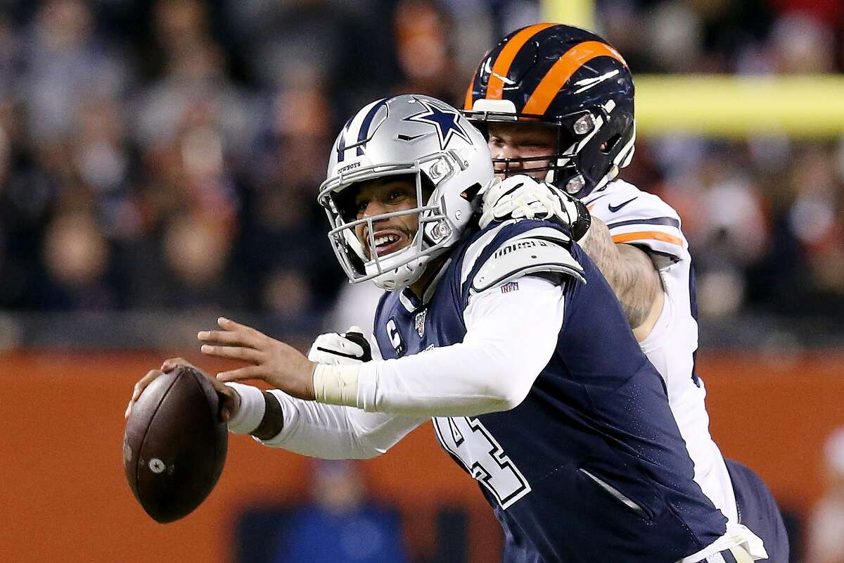 CHICAGO, ILLINOIS - DECEMBER 05: Dak Prescott #4 of the Dallas Cowboys scrambles while being pressured by Brent Urban #92 of the Chicago Bears in the third quarter at Soldier Field on December 05, 2019 in Chicago, Illinois. (Photo by Dylan Buell/Getty Images)