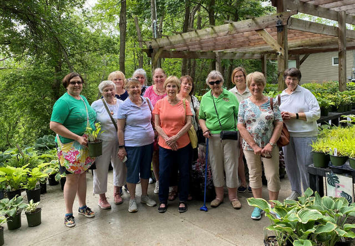 """Edwardsville Garden Club members gather together for a group photo at """"Hostas on the Bluff,"""" in Centreville, during a field trip there last month."""