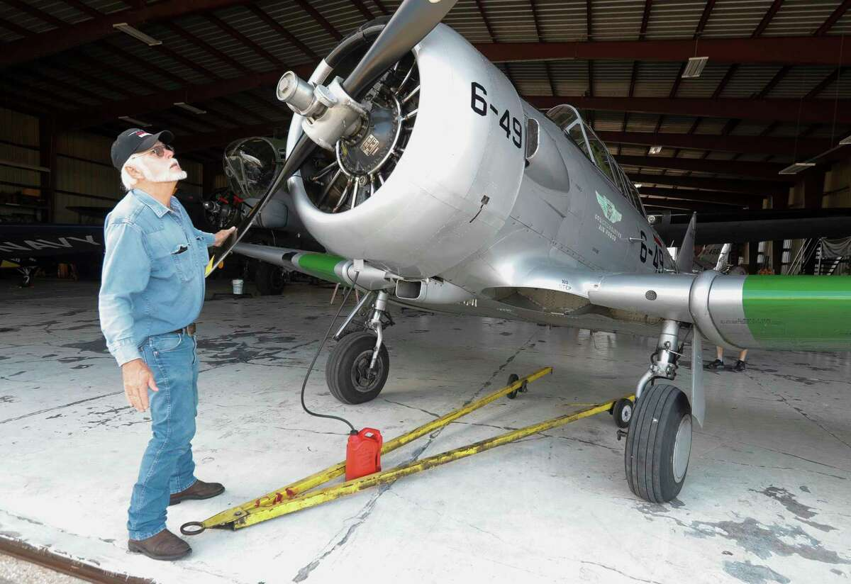 Tim Searles checks a propeller of a SNJ-5 Advance Trainer airplane as he and other members of the maintenance team with at the General Aviation Services section of the Conroe-North Houston Regional Airport, Thursday, June 10, 2021, in Conroe. The organization will have a pair of World War II planes for the community to see and tour Saturday from 1:00 p.m. - 4:00 p.m.
