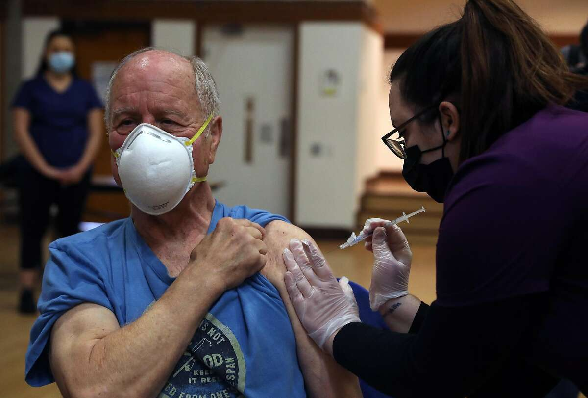 Rad Sommer, 74, of Sebastapol, receives a COVID-19 Pfizer vaccine from Shannon S., LVN with Logistics Health Incorporated/OptumServe, during a COVID-19 vaccination clinic for seniors at the Rohnert Park Community Center on Jan. 27, 2021 in Rohnert Park.