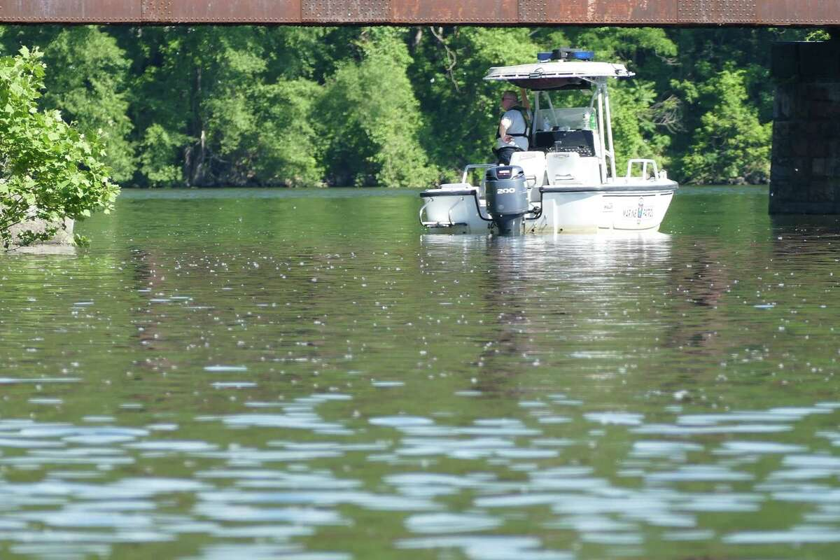 NEW MILFORD, Conn. - New Milford, Newtown and Brookfield authorities search the Housatonic just downstream of the Bleachery Dam Thursday, June 10, 2021 for two fishermen who went missing the night before.