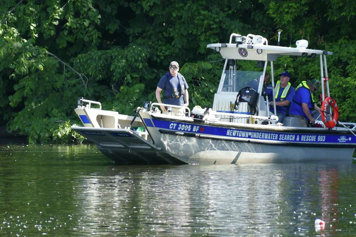 NEW MILFORD, Conn. --- New Milford and Brookfield police search the Housatonic just downstream of the Bleachery Dam Thursday, June 10, 2021 for two fishermen who went missing the night before.