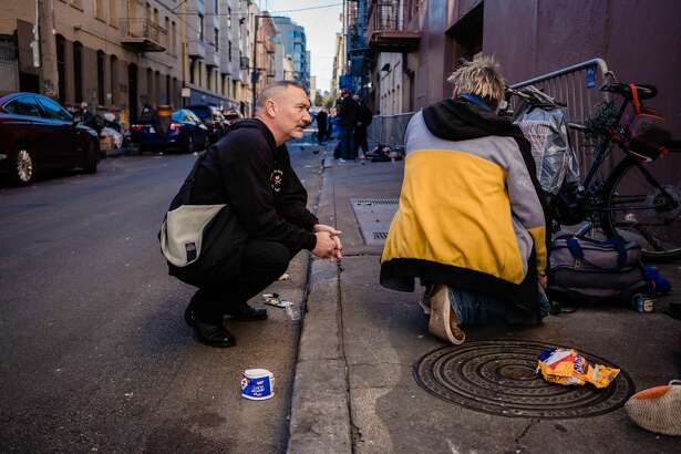 Paul Harkin, director of harm reduction at GLIDE speaks with people on a popular alley way with drug users in the Tenderloin neighborhood to handout narcan, fentanyl detection packets and tinfoil to those drug users in need as a part of outreach on the streets of San Francisco, Calif. on Feb. 3 2020.