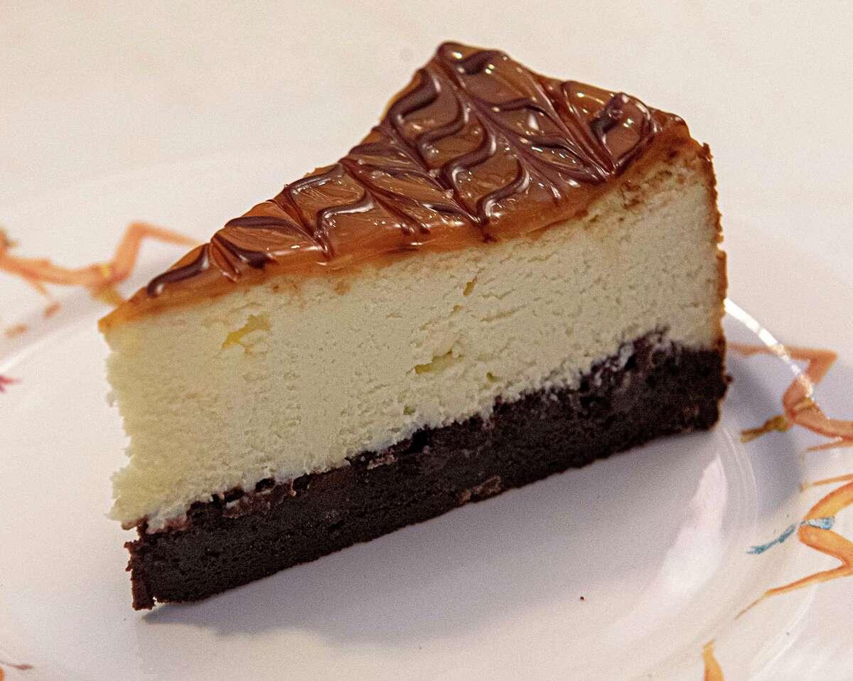 A slice of salted caramel brownie cheesecake at Cheesecake Machismo in Albany. (Lori Van Buren/Times Union)