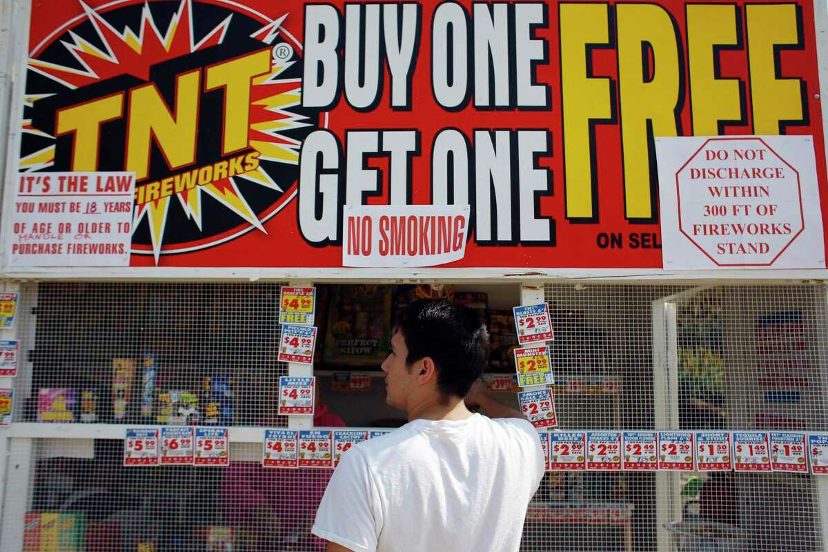 Casey Quon looks at the selection of fireworks for sale at a fundraising fireworks stand in Pacifica, Calif. on July 2, 2013. Amid extreme drought conditions and the advent of wildfire season, two Bay Area counties recently raised fines on the use of fireworks as the July 4 holiday approaches.