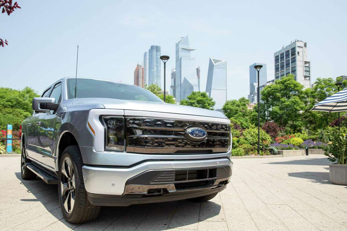 IMAGE DISTRIBUTED FOR FORD MOTOR COMPANY - All-Electric Ford F-150 Lightning on display in New York City after being revealed last week. F-150 Lightning is a pillar of the company's more than $22 billion global electric vehicle plan to lead electrification in areas of strength. F-150 Lightning will roll off the line next year at a new high-tech factory using sustainable manufacturing practices at Ford's storied Rouge complex in Dearborn just outside Detroit. Shot on Wednesday, May 26, 2021 in New York. (Ann-Sophie Fjello-Jensen/AP Images for Ford Motor Company)