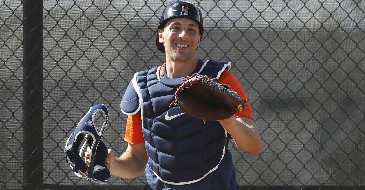 Houston Astros catcher Jason Castro (18) laughs during spring training workouts for the Astros at Ballpark of the Palm Beaches in West Palm Beach, Florida, Saturday, February 27, 2021.
