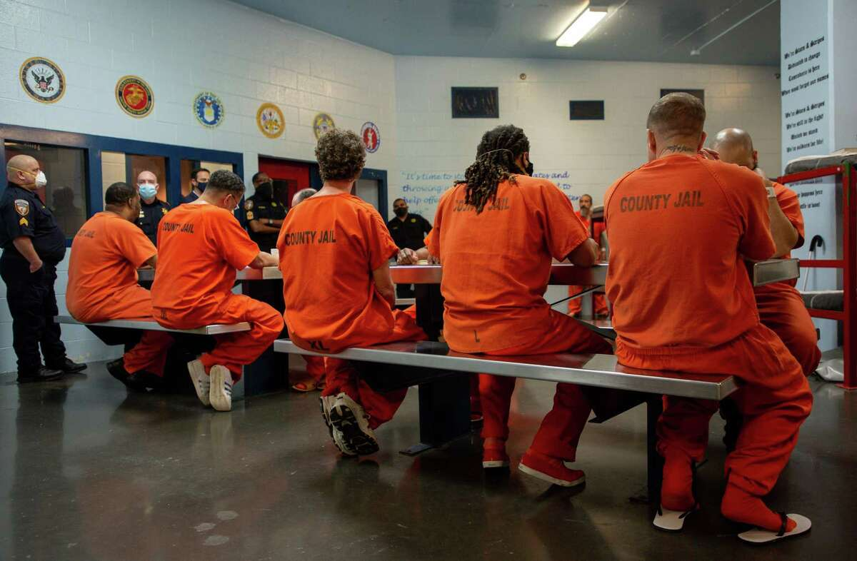 Inmates are seen inside the Harris County Jail in this January photo. Although Gov. Greg Abbott has lifted most of his pandemic restrictions, he's kept in place his order to restrict the release of any criminal defendant accused or previously convicted of a violent crime on a no-cost bond.