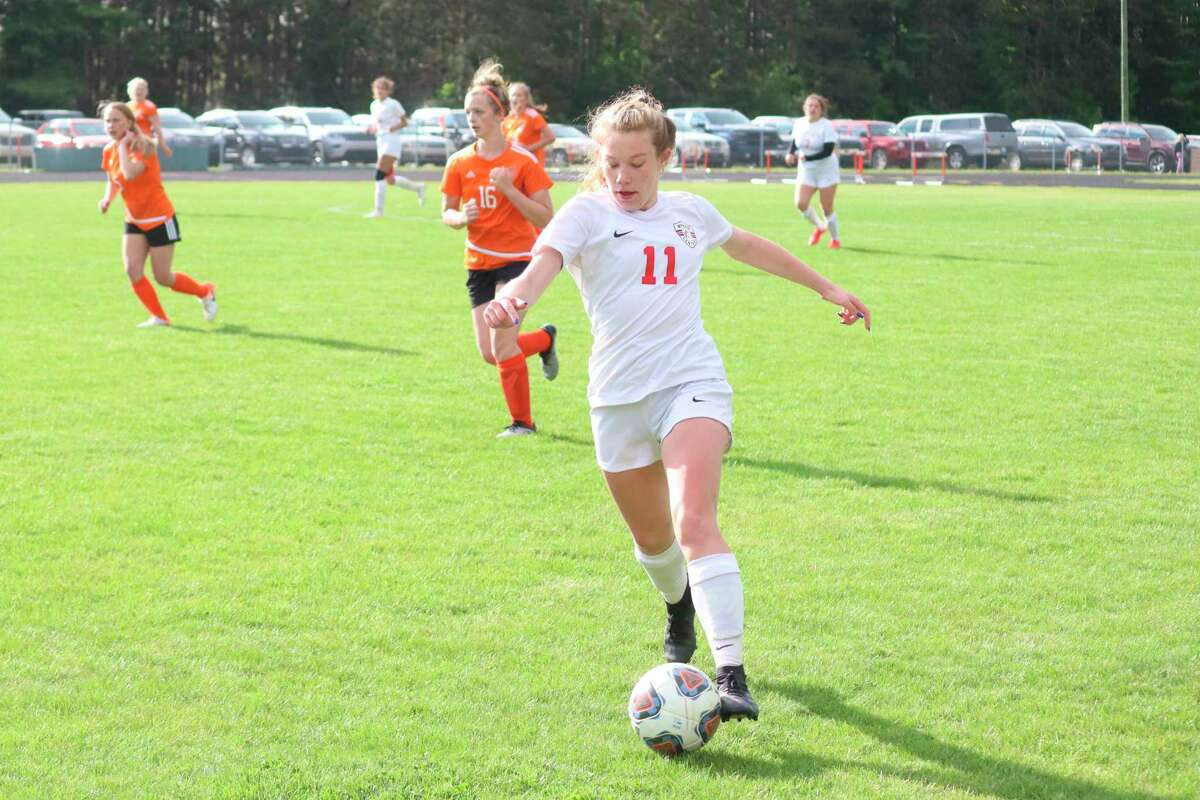 Alana Kuhlen takes the ball upfield during districts against Kingsley. (Record Patriot file photo)