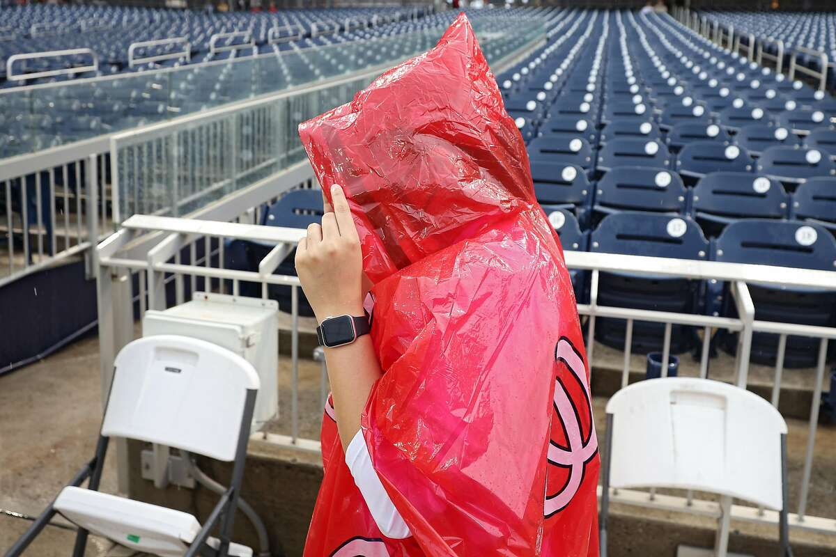 WASHINGTON, DC - JUNE 10: Fans look on after the game between the San Francisco Giants and Washington Nationals was postponed due to rain at Nationals Park on June 10, 2021 in Washington, DC. The game has been rescheduled as a split doubleheader on June 12. (Photo by Patrick Smith/Getty Images)