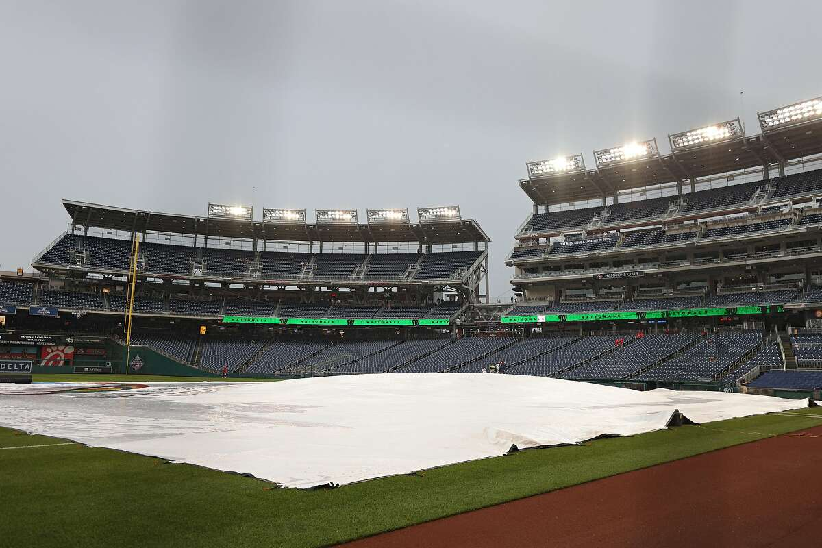WASHINGTON, DC - JUNE 10: The infield tarp is seen after the game between the San Francisco Giants and Washington Nationals was postponed due to rain at Nationals Park on June 10, 2021 in Washington, DC. The game has been rescheduled as a split doubleheader on June 12. (Photo by Patrick Smith/Getty Images)
