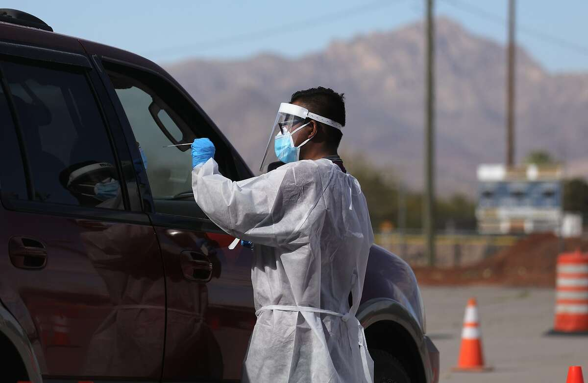 EL PASO, TEXAS - NOVEMBER 13: A frontline healthcare worker administers a swab test at a COVID-19 testing site amid a surge of coronavirus cases on November 13, 2020 in El Paso, Texas. Texas eclipsed one million COVID-19 cases November 11th with El Paso holding the most cases statewide. Health officials in El Paso today announced 16 additional COVID-19 related deaths along with 1,488 new cases pushing the virus death toll to 741. Active cases in El Paso are now over 30,000. (Photo by Mario Tama/Getty Images)