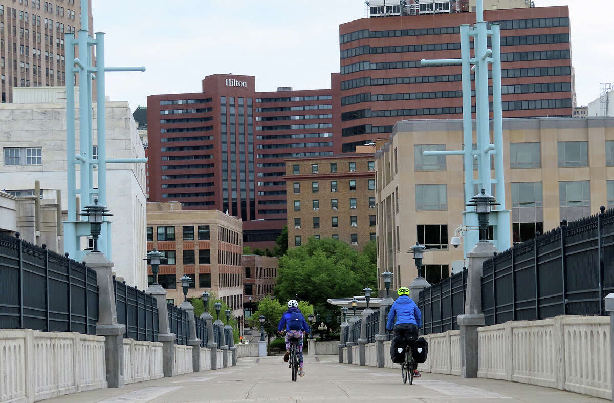 Gillian Scott and her daughter ride into downtown Albany from the Empire State Trail.