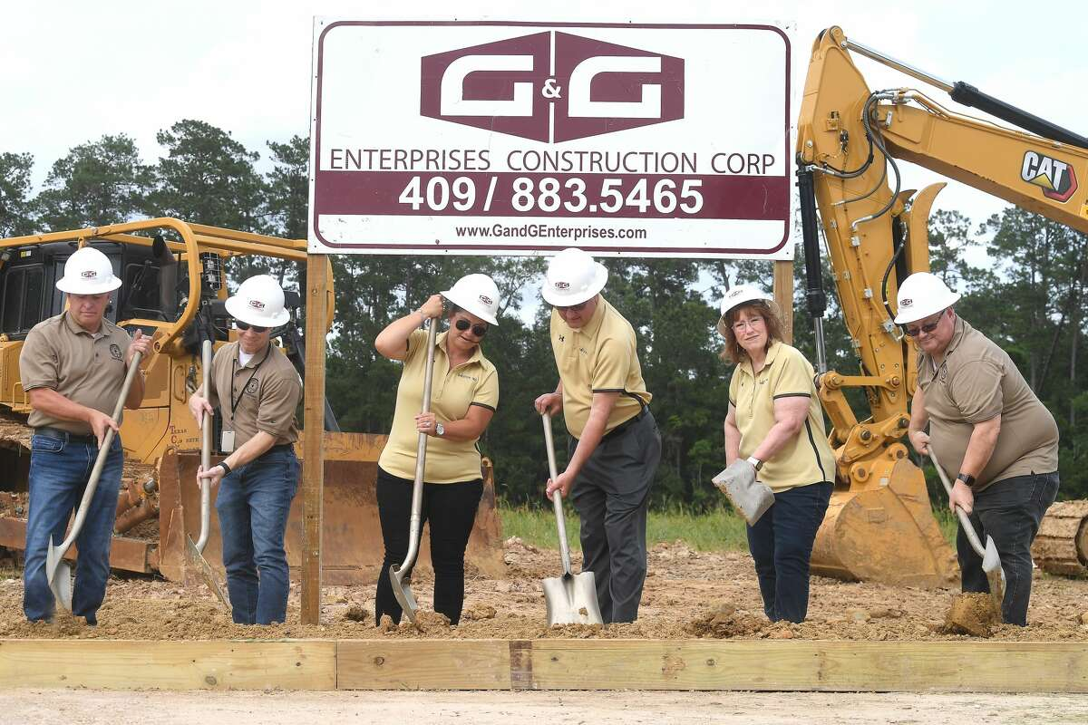 Members of Vidor ISD's school board gather for a groundbreaking ceremony on the long-awaited new Vidor Middle School Thursday. Students and teachers have been working out of portables since the school flooded during Harvey in 2017. Photo made Thursday, June 10, 2021 Kim Brent/The Enterprise