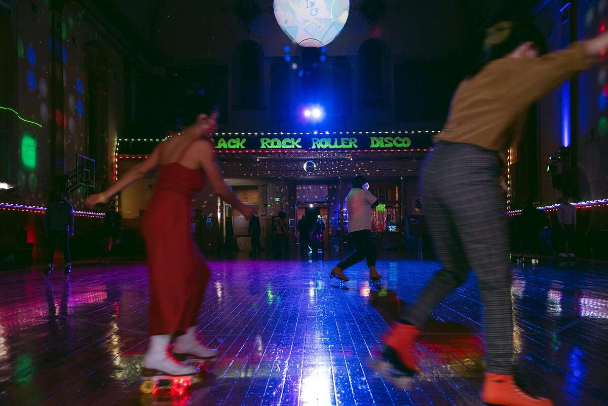 Roller skaters enjoy the recently reopened rink at Church of 8 Wheels Roller Disco in San Francisco on Saturday, March 13, 2021.