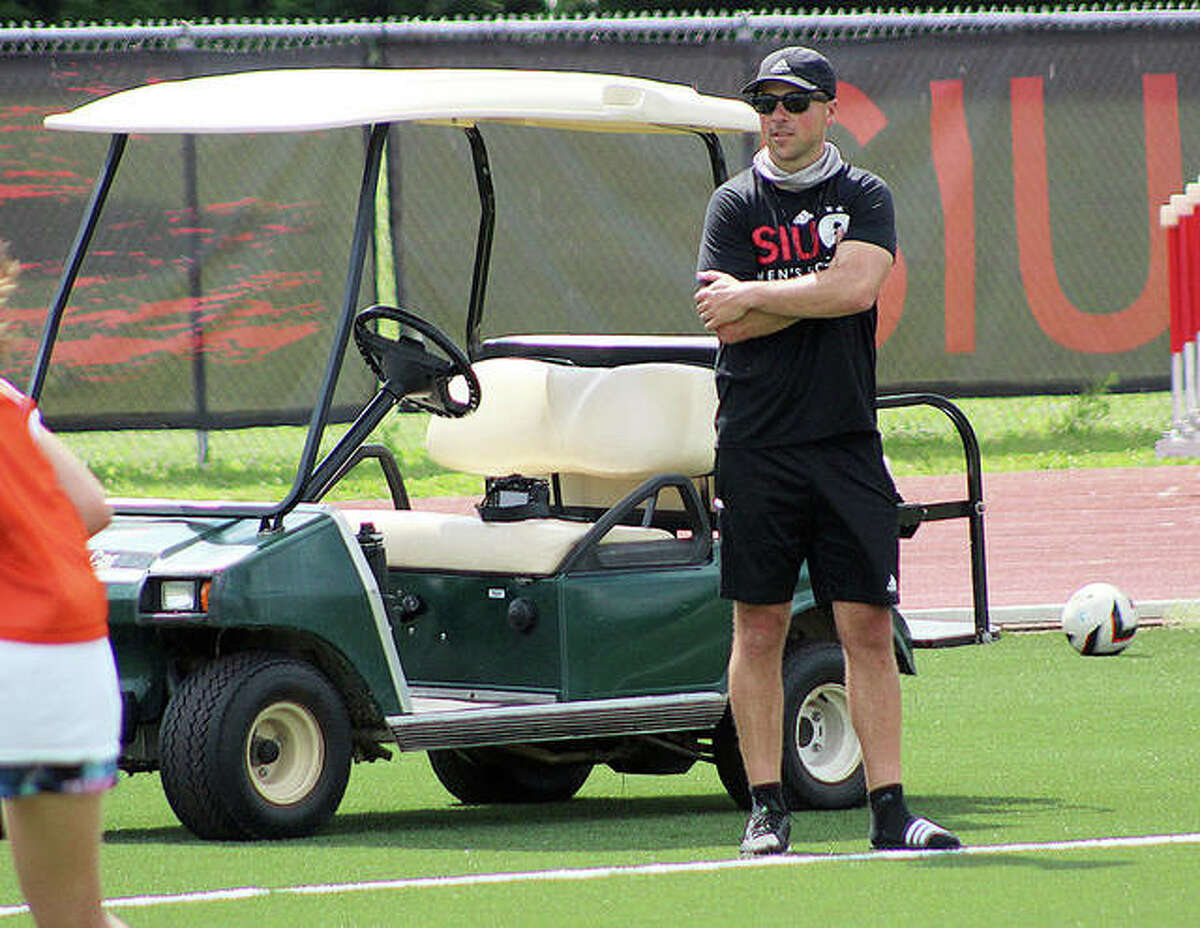 SIUE men's soccer coach Cale Wasserman watches a scrimmage Thursday morning at Korte Stadium during a session of the Cougars Soccer Camp, which runs through Friday.