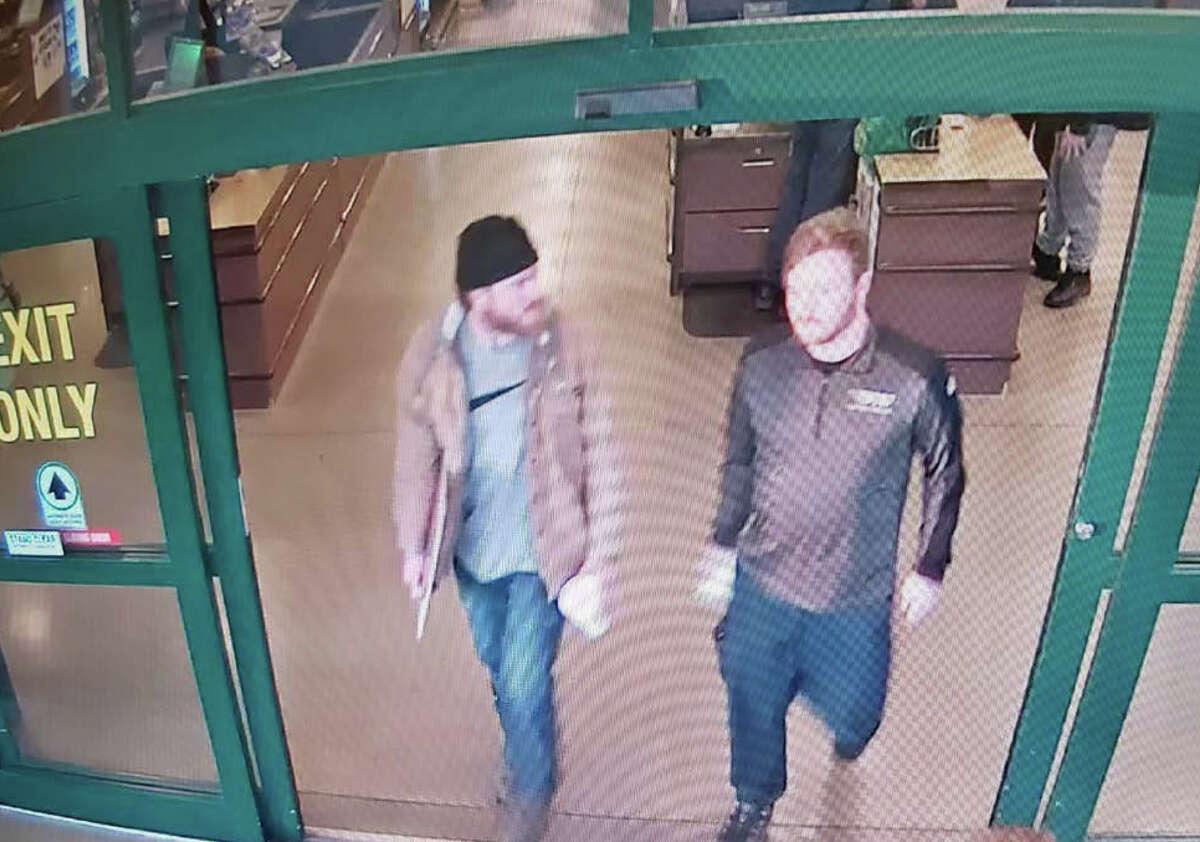 Patrik Jordan Mathews, left, and Brian Mark Lemley Jr. on surveillance video leaving a store in Delaware.