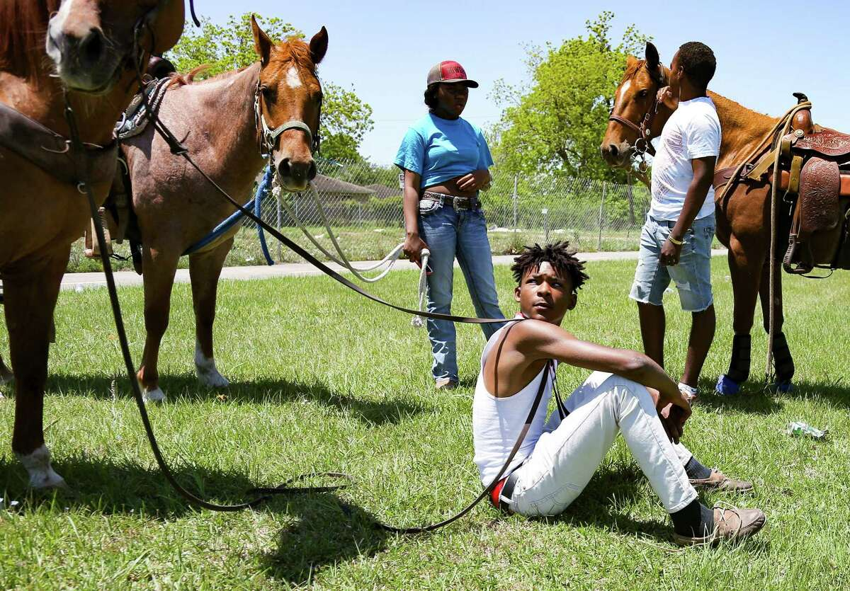 """Trenton Jamar Coleman, 16 of Hitchcock has been riding since he was age 3. He learned from his dad, his dad was taught how to ride from his dad. """"It feels good to know people are starting to care about history and more people are starting to celebrate it,"""" he said during a ride through Texas City and LaMarque on April 25, 2021. The settlement community, the only one in Galveston County, was started by former slaves who worked as ranch hands."""