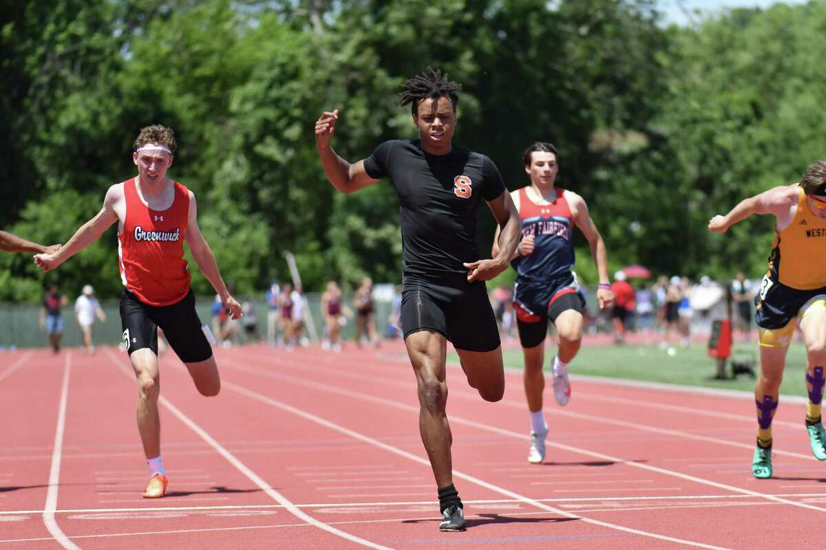 Shelton's Jason Lorent wins the 200 meter dash during the CT State Open Track and Field Championship on June 10, 2021 at Willow Brook Park in New Britain, CT.