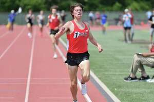 Conard's Gavin Sherry wins the 3,200-meter run during the State Open Track and Field Championship on Thursday at Willow Brook Park in New Britain.