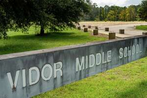 The old sign for the middle school stands in front of the recently cleared land that will be the home of the rebuilt school. The Viidor ISD has begun working on the rebuilding of Vidor Middle School and Oak Forest Elementary School. Photo made on October 12, 2020. Fran Ruchalski/The Enterprise