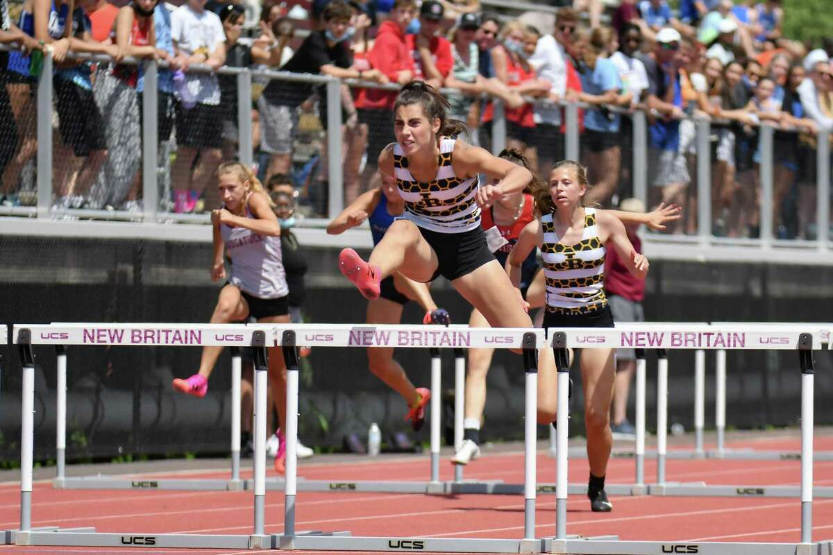 Barlow's Mariella Schweitzer cruises to victory in the 100 hurdles at the State Open on June 10. Schweitzer set records in the 300 hurdles at the State Open and Class MM meet.