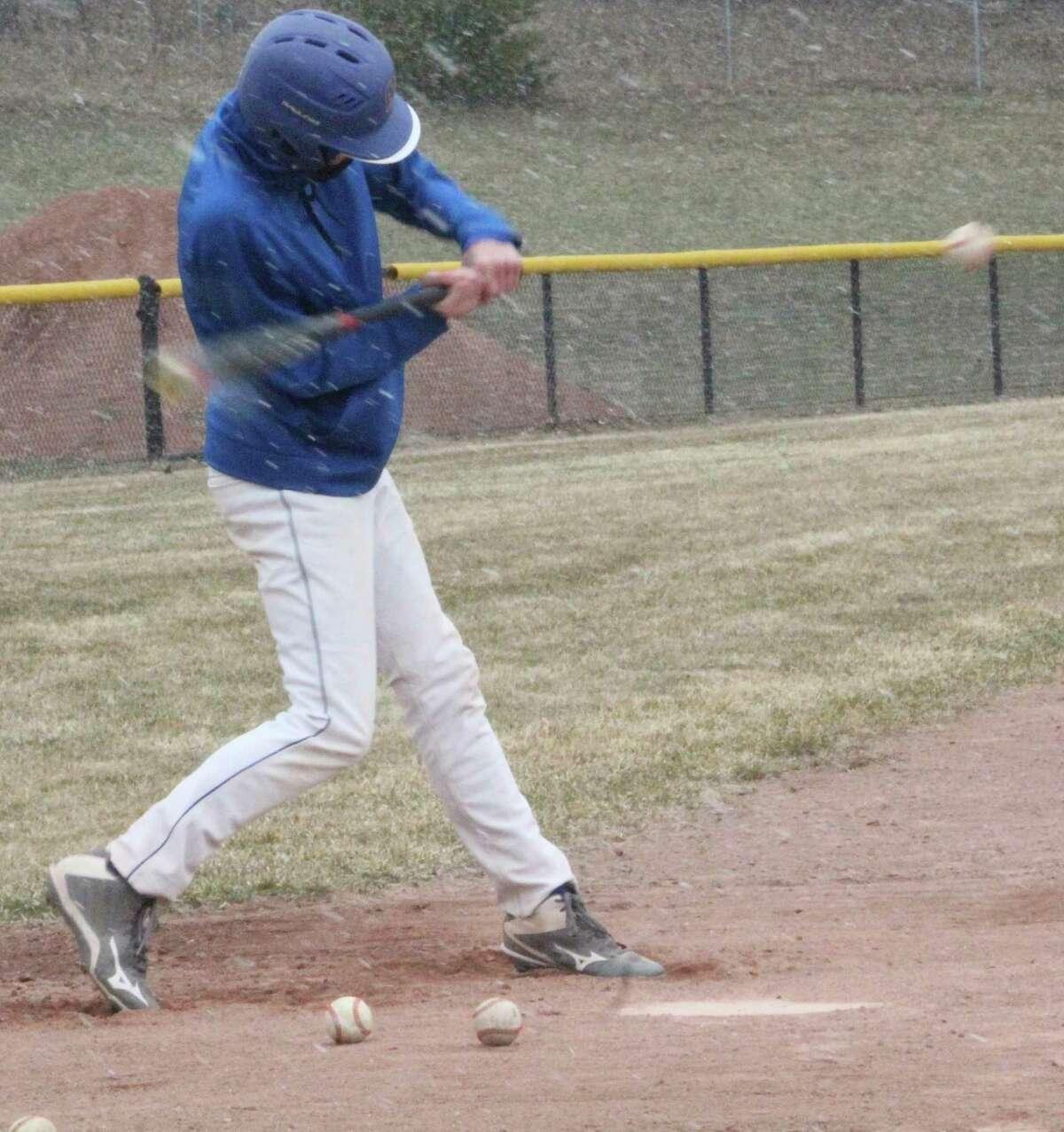Evart's Pierce Johnson works on his hitting at a practice earlier this season. (Pioneer file photo)